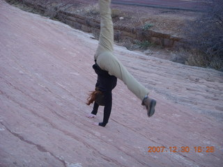 399 6cw. Zion National Park - slickrock - gymnastic girl doing cartwheel