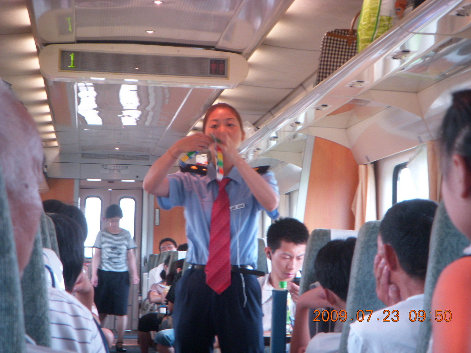 China eclipse - Hangzhou to Shanghai train ride - lady selling toys