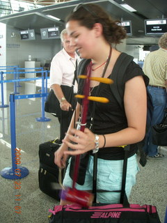 China eclipse - Shanghai airport - lady with interesting musical instrument