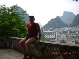 45 6xr. China eclipse - Yangshuo steps up the mountain - Adam at the summit (backlit)