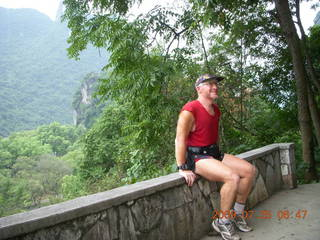 46 6xr. China eclipse - Yangshuo steps up the mountain - Adam at summit (the good one)
