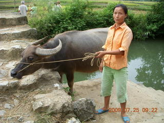 111 6xr. China eclipse - Yangshuo bicycle ride - lady with water buffalo