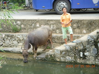 122 6xr. China eclipse - Yangshuo bicycle ride - walk to farm village - lady with water buffalo