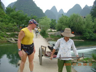 132 6xr. China eclipse - Yangshuo bicycle ride - walk to farm village - Adam and farm worker