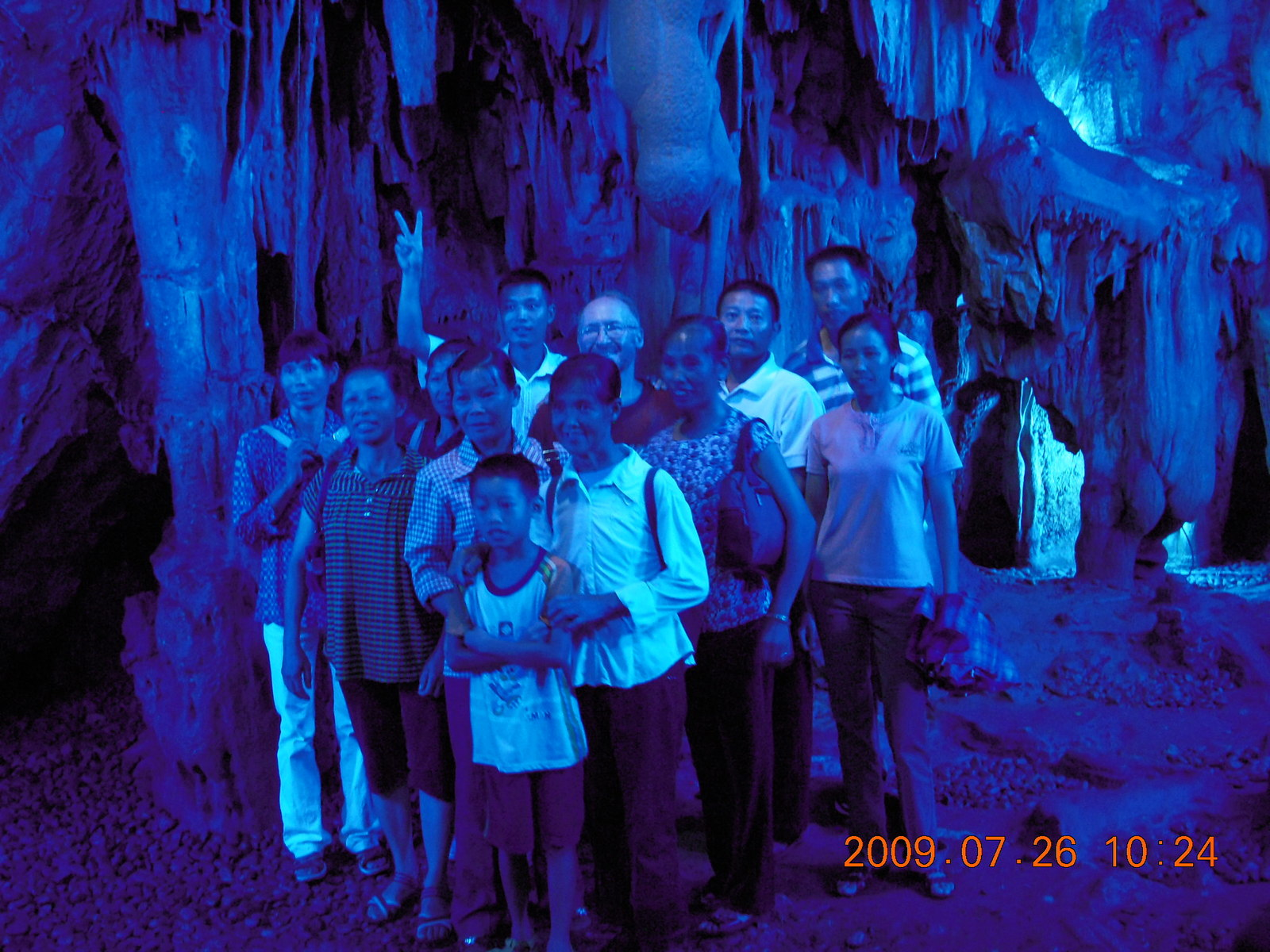 China eclipse - Guilin - Reed Flute Cave (really low light, extensive motion stabilization) - crowd and Adam