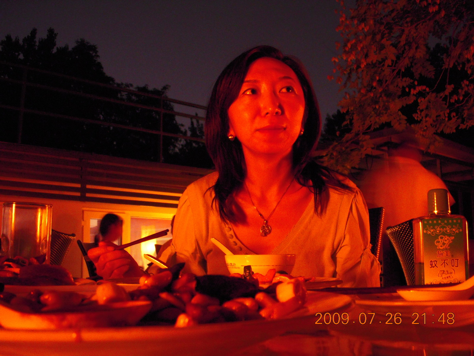 China eclipse - Sonia at restaurant in park in Beijing (low light)