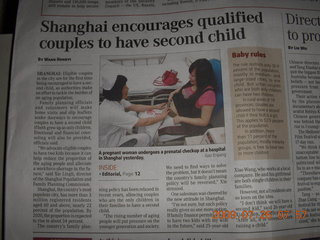 7 6xs. China eclipse - newspaper article about second-child laws