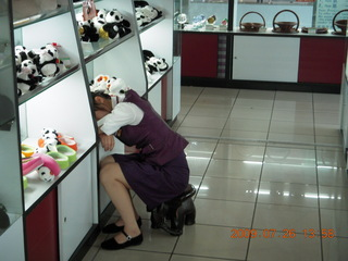 125 6xs. China eclipse - Guilin airport - sleepy store worker