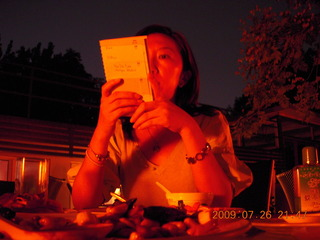 China eclipse - Sonia reading menu at restaurant (low light)