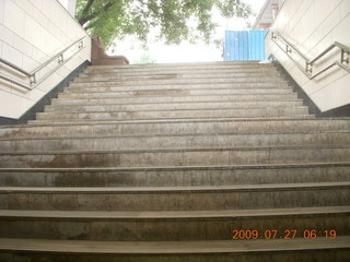 China eclipse - Beijing morning run - stairs back to street level