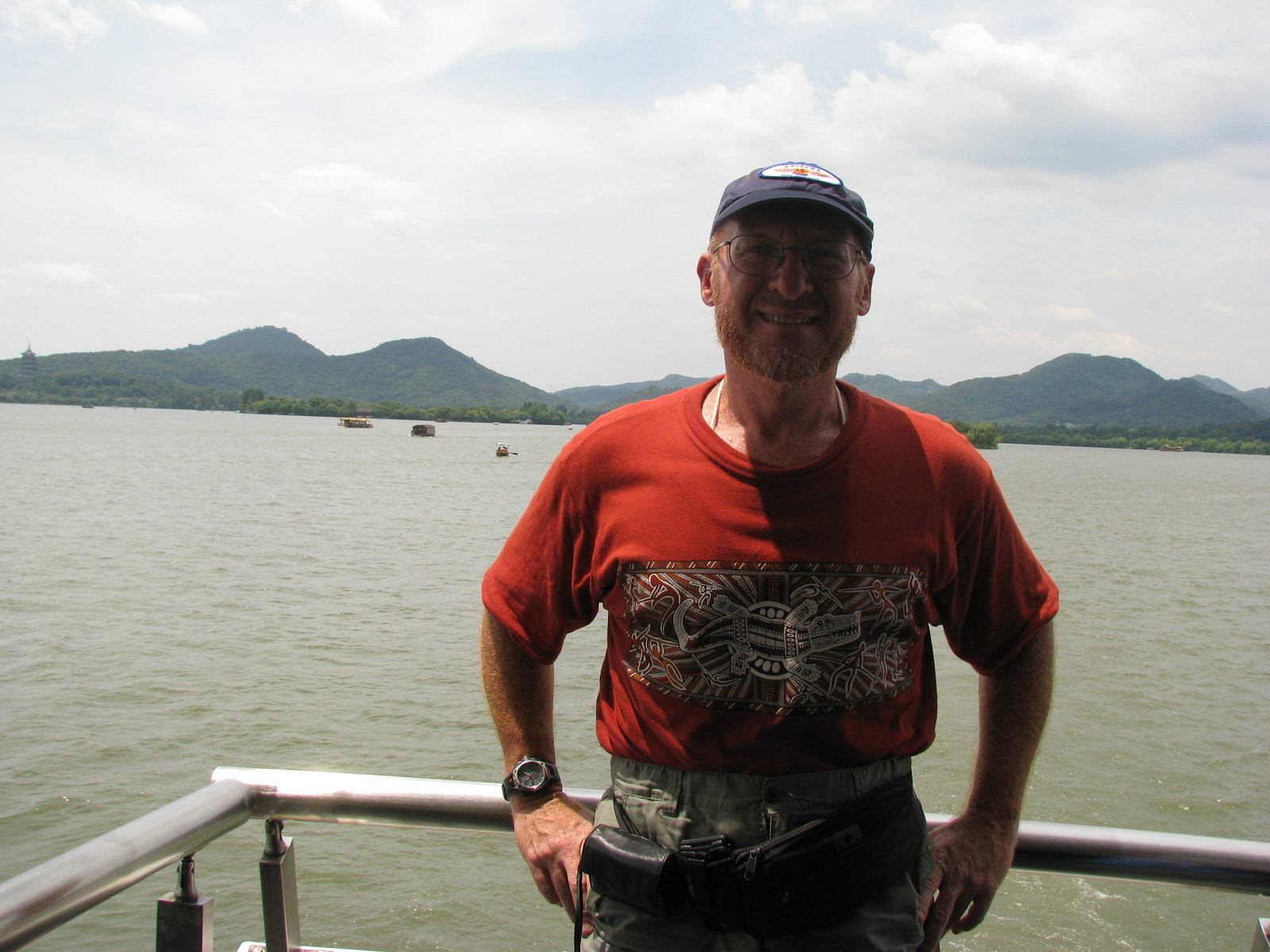 China eclipse - Mango's pictures - Adam on West Lake boat ride